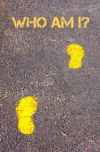 Yellow footsteps on sidewalk towards Who Am I message — Стоковое фото