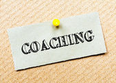 Recycled paper note pinned on cork board.Coaching Message. Concept Image — Stockfoto