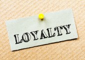 Recycled paper note pinned on cork board.Loyalty  Message. Concept Image — Stock Photo