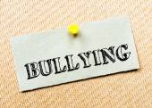 Recycled paper note pinned on cork board. Bullying Message. Concept Image — Foto Stock