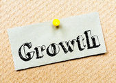 Recycled paper note pinned on cork board. Growth Message — Stock Photo