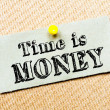 Recycled paper note pinned on cork board. Time is Money Message — Stock Photo #67055547
