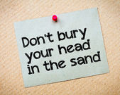 Don't bury your head in the sand — Stock Photo