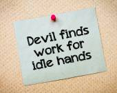 Devil finds work for idle hands — Stock Photo