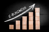 Word E-Business on ascending arrow above bar graph — Stock Photo