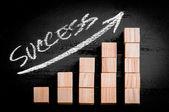 Word Success on ascending arrow above bar graph — Stock Photo