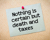 Nothing is certain but death and taxes — Stock Photo