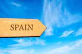 Wooden arrow sign pointing destination SPAIN — Stock Photo