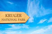 Wooden arrow sign pointing destination KRUGER NATIONAL PARK — Stock Photo