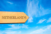 Wooden arrow sign pointing destination NETHERLANDS — Stock Photo