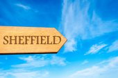 Wooden arrow sign pointing destination SHEFFIELD, ENGLAND — Stock Photo