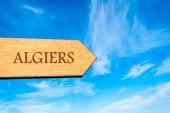 Wooden arrow sign pointing destination ALGIERS, ALGERIA — Stock Photo
