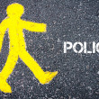 Yellow pedestrian figure walking towards POLICY — Stock Photo #72806749