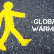 Yellow pedestrian figure walking towards GLOBAL WARMING — Stock Photo #72806787