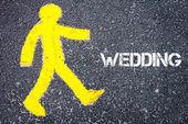 Yellow pedestrian figure walking towards WEDDING — Stock Photo