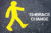 Pedestrian figure walking towards EMBRACE CHANGE — Foto de Stock