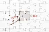 Missing jigsaw puzzle piece completing word POSSIBLE — Stock Photo
