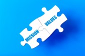 Connected puzzle pieces with words MISSION and VALUES — Stock Photo