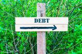 DEBT Directional sign — Stock Photo