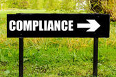 COMPLIANCE written on directional black metal sign — Stock Photo