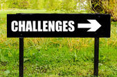 CHALLENGES written on directional black metal sign — Stock Photo