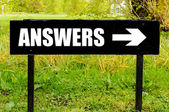 ANSWERS written on directional black metal sign — Stock Photo