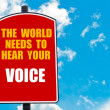 The World Needs to Hear Your Voice written on road sign — Stock Photo #74687623