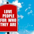 Love People For Who They Are written on road sign — Stock Photo #74687627