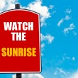 Watch The Sunrise written on road sign — Stock Photo #74687671