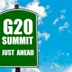 G20 SUMMIT Just Ahead written on green road sign — Stock Photo #74760919