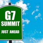 G7 SUMMIT Just Ahead written on green road sign — Stock Photo #74760945