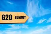 Wooden arrow sign pointing destination G20 SUMMIT — Stockfoto