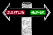 Opposite arrows with Question versus Answer — Stock Photo