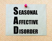 SAD as Seasonal Affective Disorder written on paper note — Stock Photo