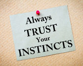 Always Trust Your Instincts Message written on paper note — Stock Photo