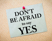Don't Be Afraid To Say YES Message written on paper note — Stock Photo