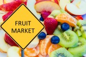 Yellow roadsign with message FRUIT MARKET — Stock Photo