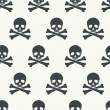 Seamless pattern with skulls. — Stock Vector #53399989
