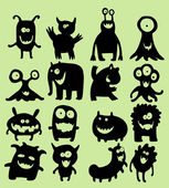 Cute little smiling monsters — Stock Vector