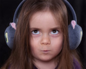 Child with earmuffs — Stock Photo