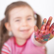 Little girl show on colored finger — Stock Photo #54400241