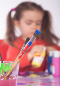 Painting Utensils with Girl in the Background — Stockfoto