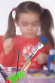 Painting Utensils with Girl in the Background — Stock Photo