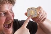 Man with Eggtimer in his hand is looking very angry — Stock Photo