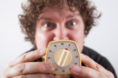 Man with eggtimer in his hands — Stock Photo
