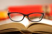 Glasses are laying on a book — Stock Photo