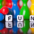 Cube Letters show the word fun — Stock Photo #62823451