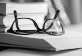 Black and white Picture of glasses on a book — Stock Photo