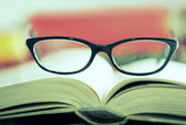Glasses are laying on a book Cross Prozessed — Stock Photo