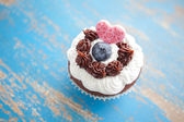 Decorated Cupcake with Heart Shaped Candy — Stock Photo